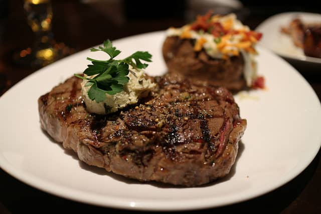 image of a steak and potato on a plate