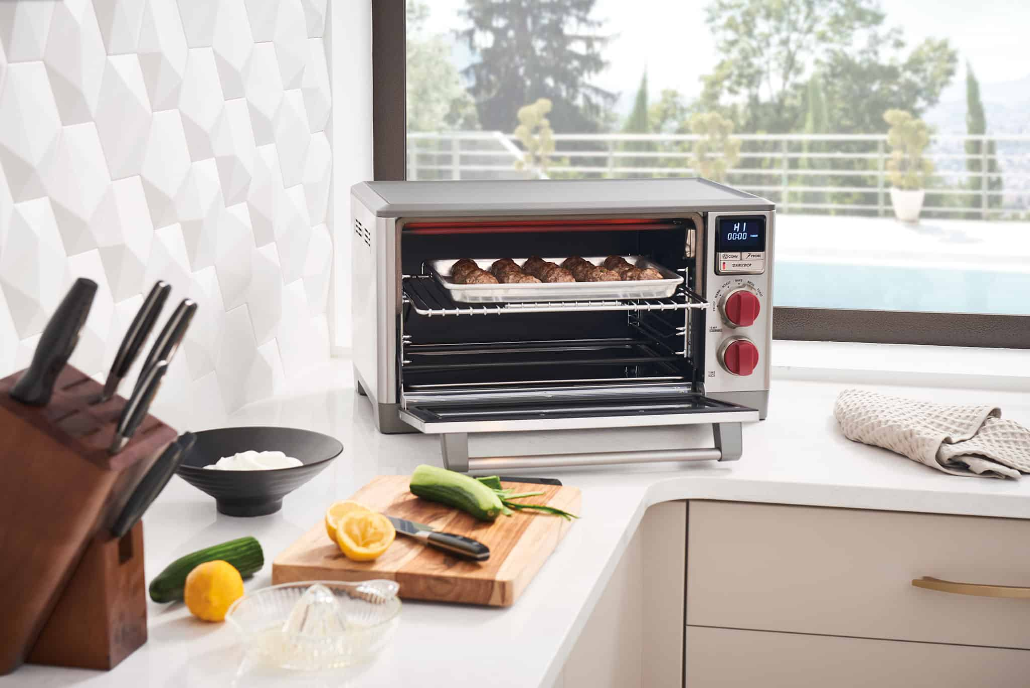 image of Wolf Gourmet Countertop Oven, open door with meatballs