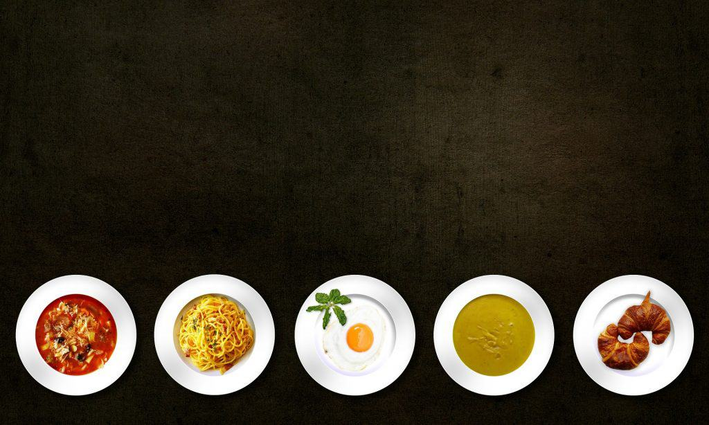 image of artfully arranged food servings on a black table