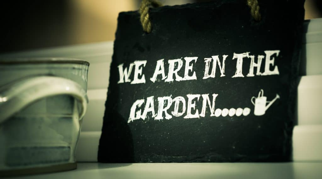 "image of a sign that reads ""we are in the garden..."""