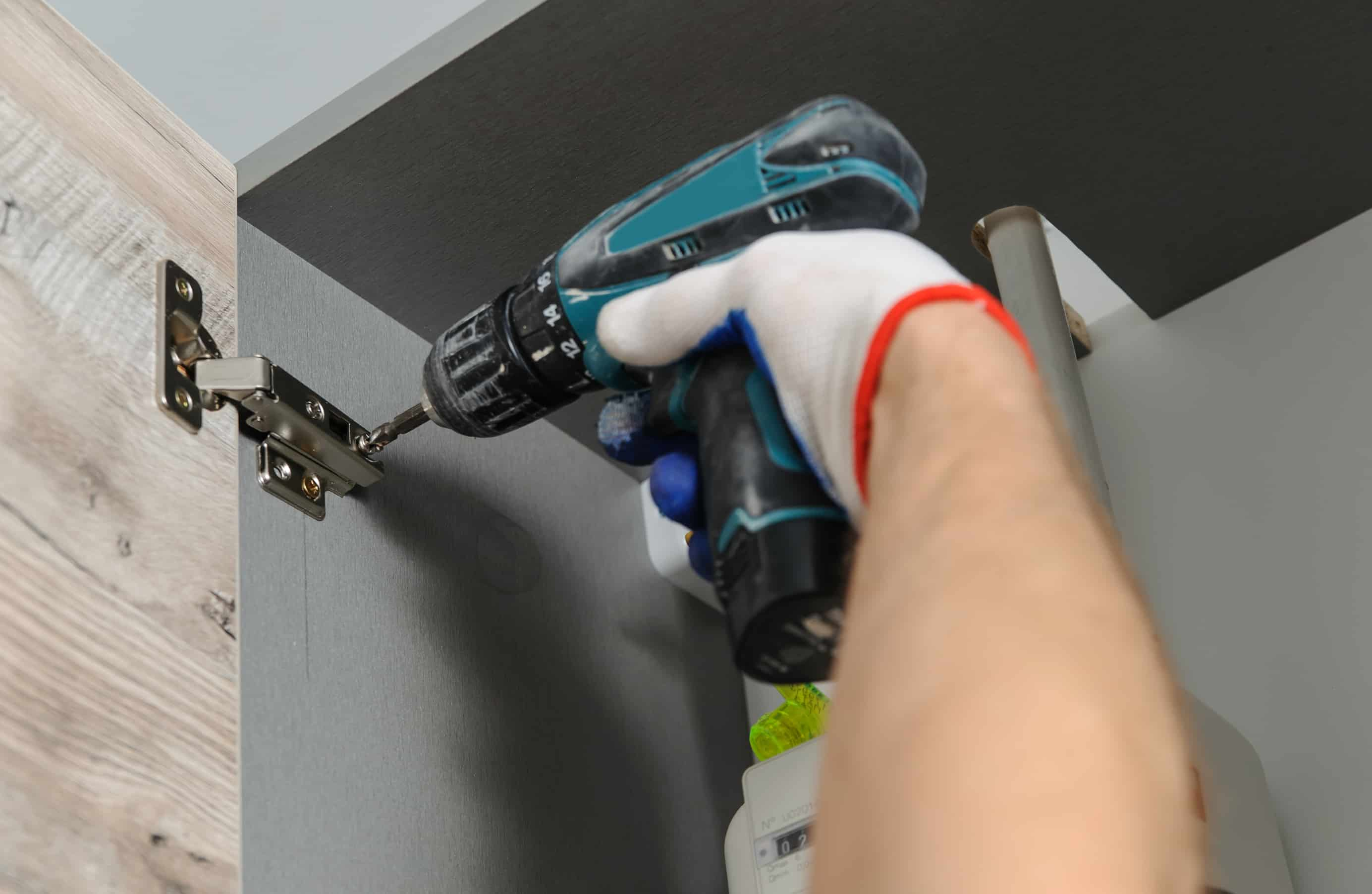 image of drill installing Kitchen Cabinet door hinge